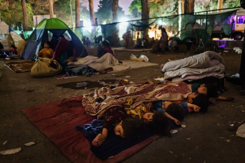 Children sleep in a makeshift camp.