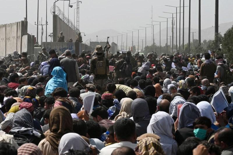 Afghans gather on a roadside.
