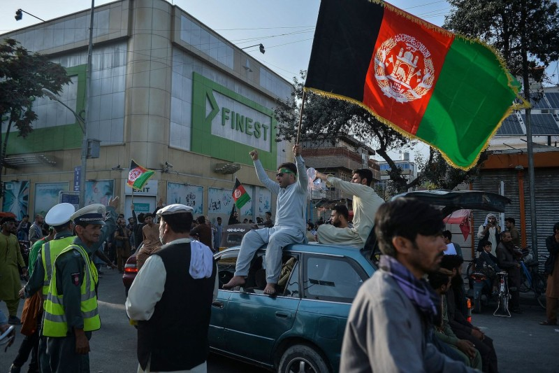 People carry Afghanistan's flag.