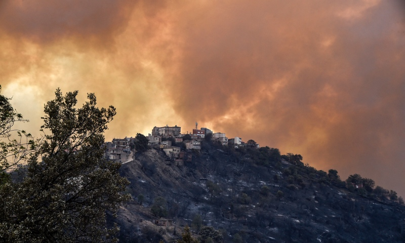 Smoke rises from a wildfire in the forested hills of Algeria's Kabylia region on Aug. 10.