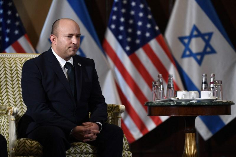 Israeli Prime Minister Naftali Bennett listens to U.S. Secretary of State Antony Blinken.
