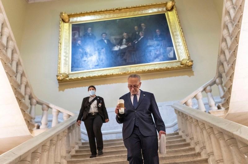 Senate majority leader walks to office.