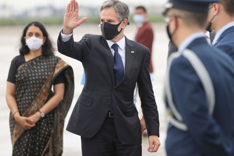 U.S. Secretary of State Antony Blinken bids farewell as he boards his plane at the New Delhi airport to depart for Kuwait on July 28.