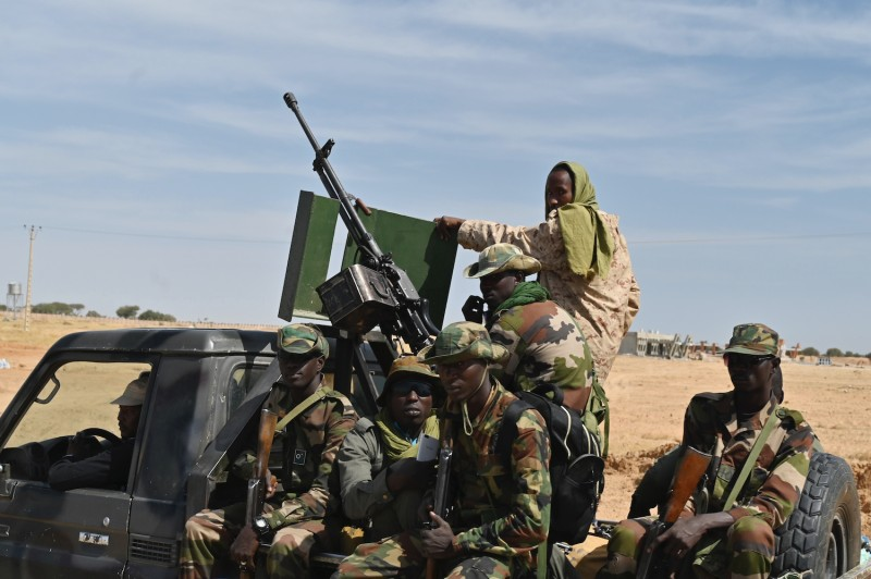 Nigerian soldiers patrol outside the Diffa Airfield in southeast Niger, near the Nigerian border, on Dec. 23, 2020.