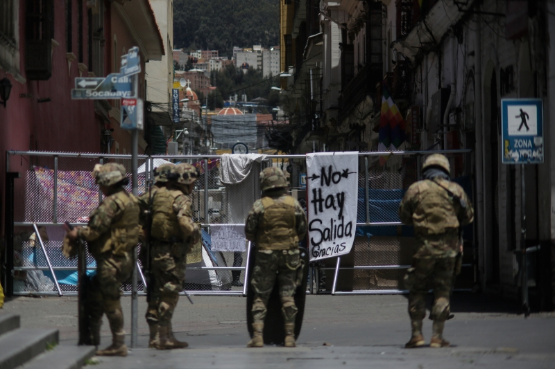 Military officers stand next to a barricade in Plaza Murillo in La Paz, Bolivia, on Nov. 24, 2019.