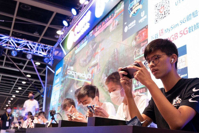Visitors play video games at the annual Animation-Comic-Game in Hong Kong on July 24.