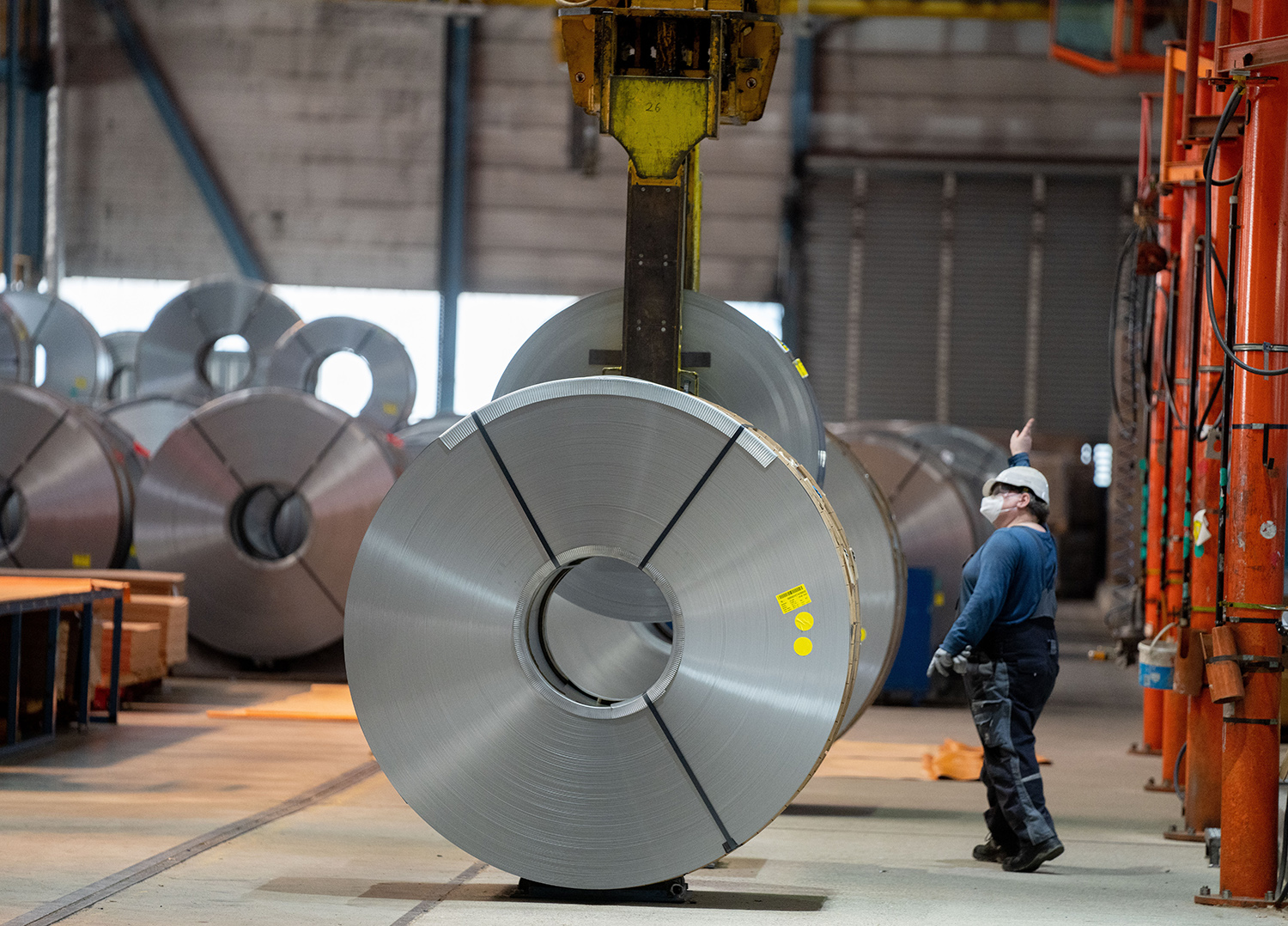 Galvanized and coiled metal strips are transported and stored at the ArcelorMittal steel group, which processes green steel in Brandenburg, Germany, on June 18.