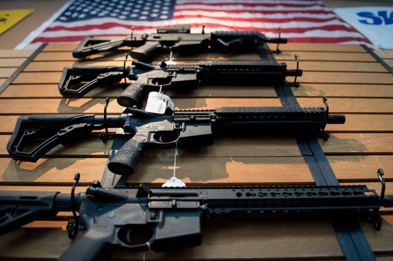 Assault rifles are displayed for sale at Blue Ridge Arsenal in Chantilly, Virginia, on Oct. 6, 2017.