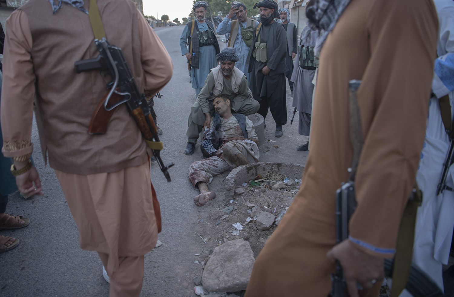 A wounded militiaman from Khan's forces is attended to during a clash with Taliban forces inside Herat city on Aug. 2.