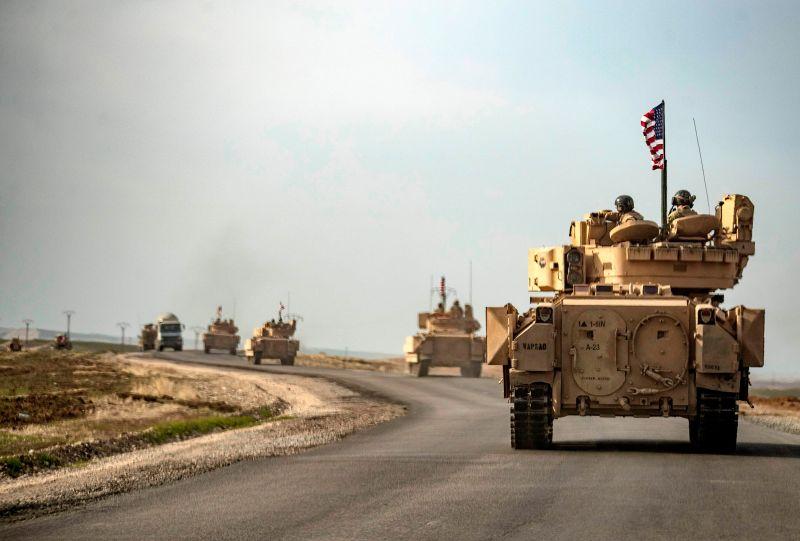 U.S. soldiers in Bradley tanks near the Iraq-Syria border