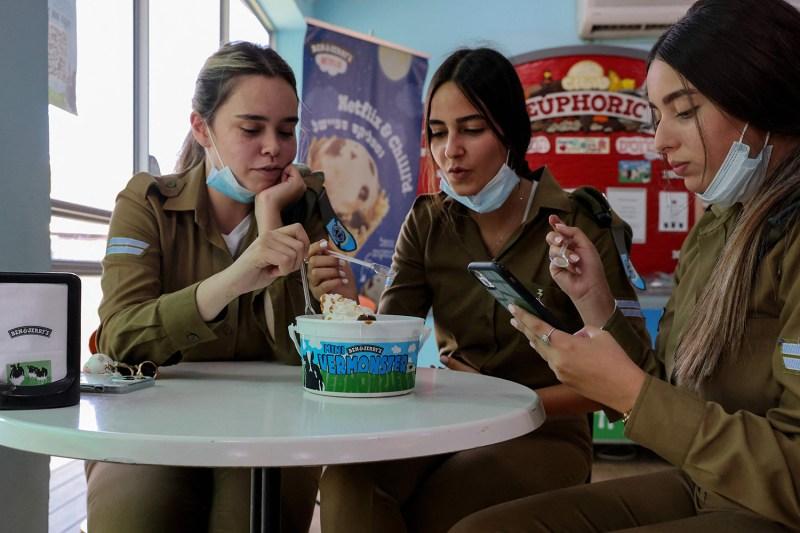 Israeli soldiers eat ice cream.