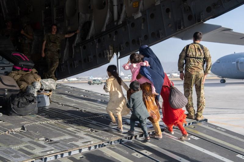 Passengers board an Air Force plane at Kabul airport