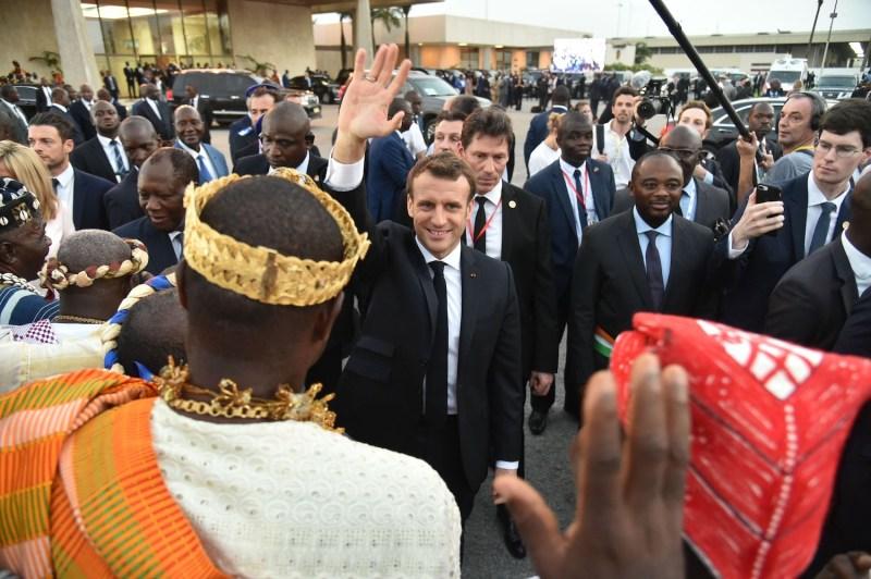 French President Emmanuel Macron greets people at Félix Houphouët Boigny International Airport in Abidjan, Ivory Coast, on Dec. 20, 2019.