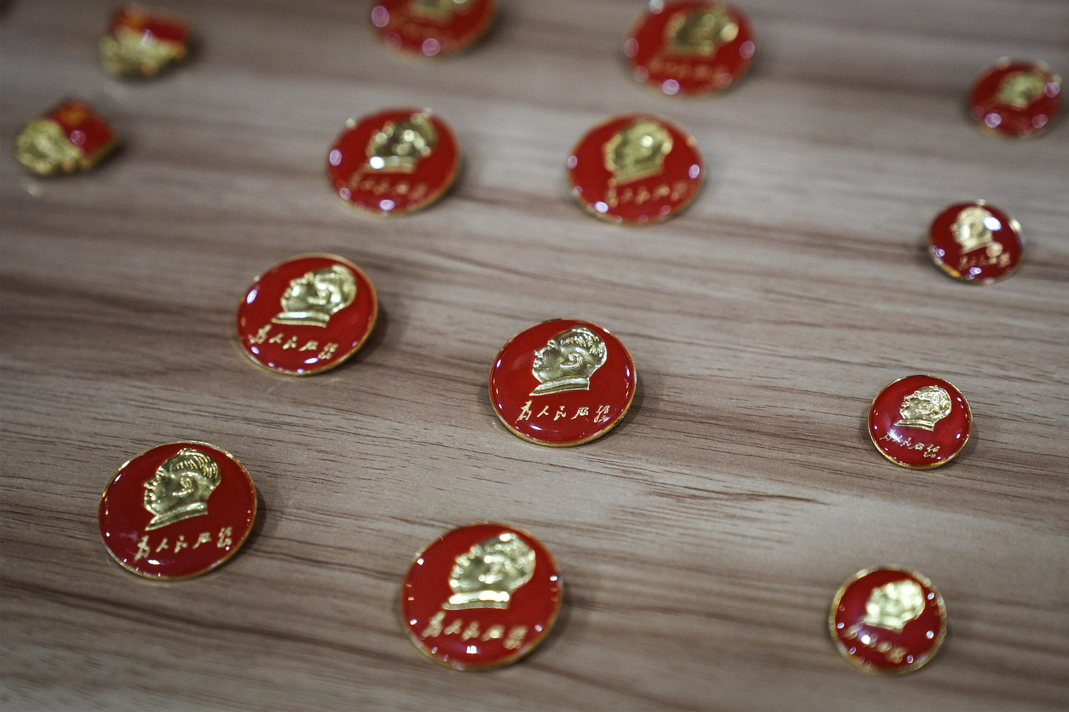 Mao Zedong badges are seen in the souvenir shop of his former residence on Oct. 7, 2020, in Wuhan, China.