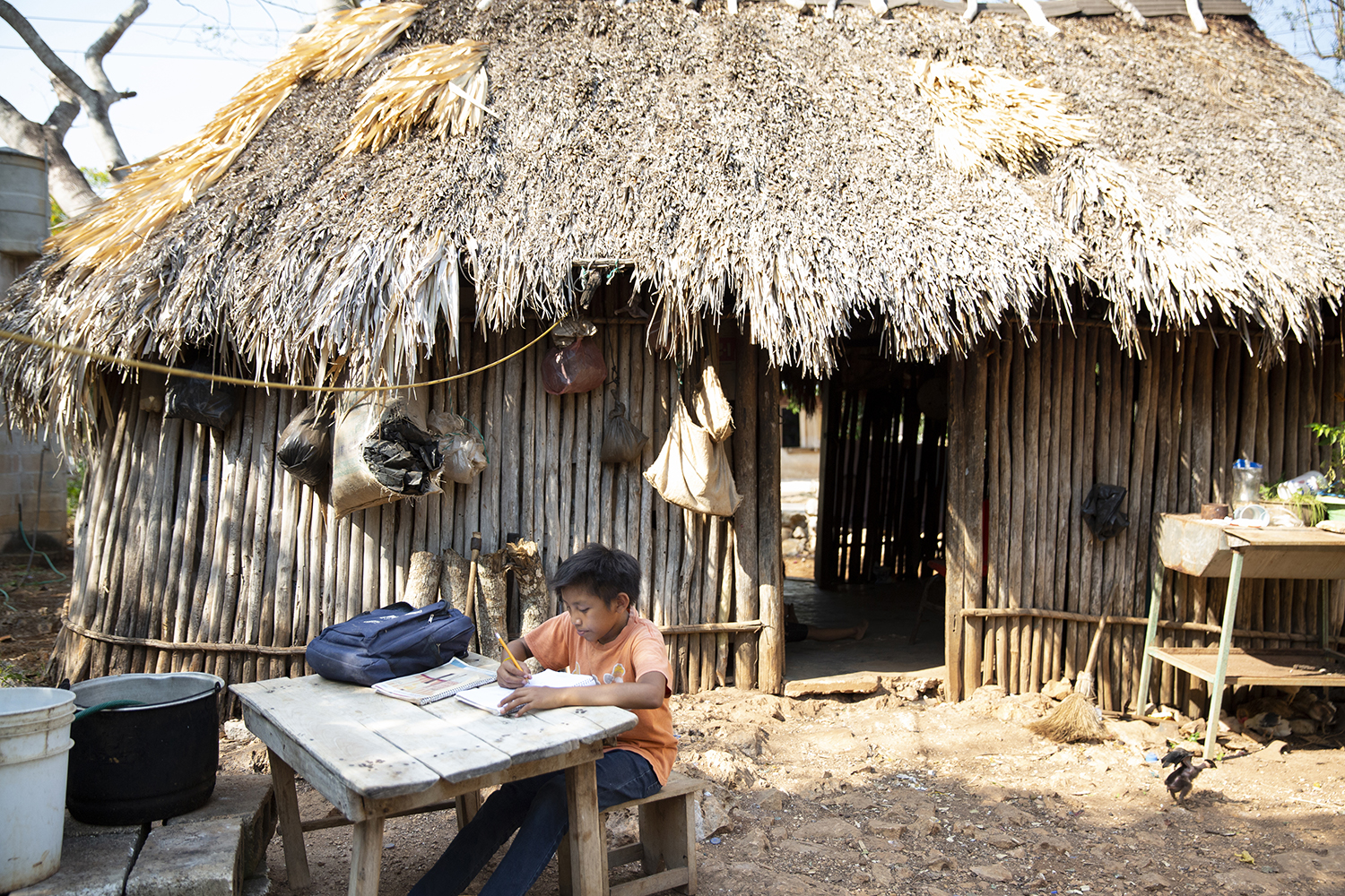 Rodrigo Tuz Díaz, 11, a student at the Ignacio Ramírez Calzada primary school, works on his schoolwork at his home in the Indigenous community of Celtún, Yucatán state, Mexico, on May 3, as schools remain closed due to the COVID-19 pandemic.