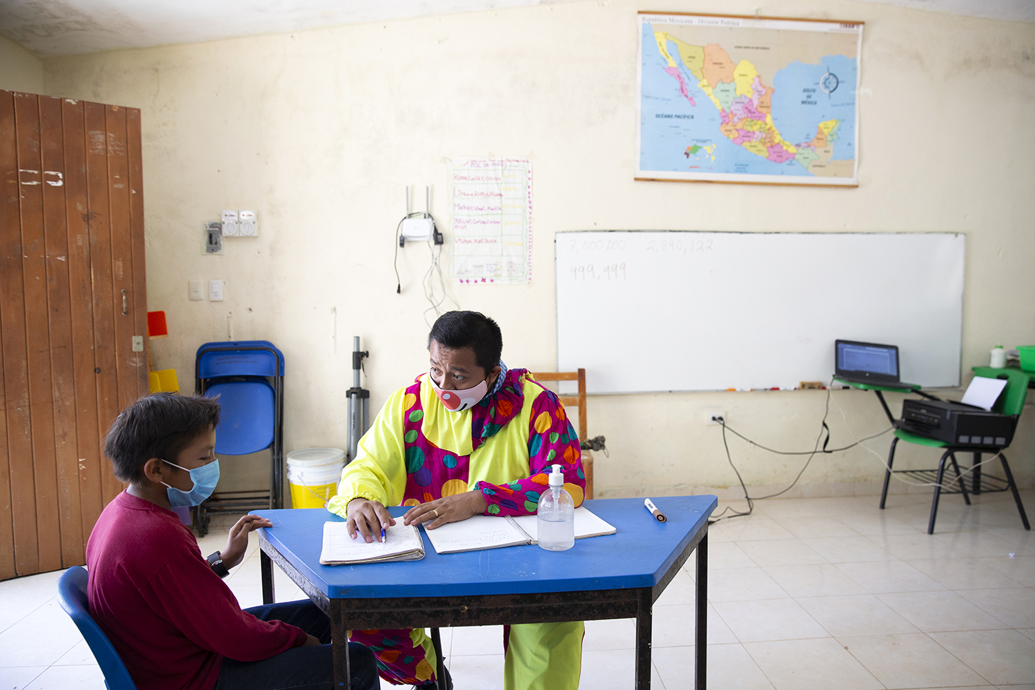 Headmaster José Manuel Cen Kauil teaches a small class of students ranging from ages 9 to 11 at the Ignacio Ramírez Calzada primary school in Celtún on May 3