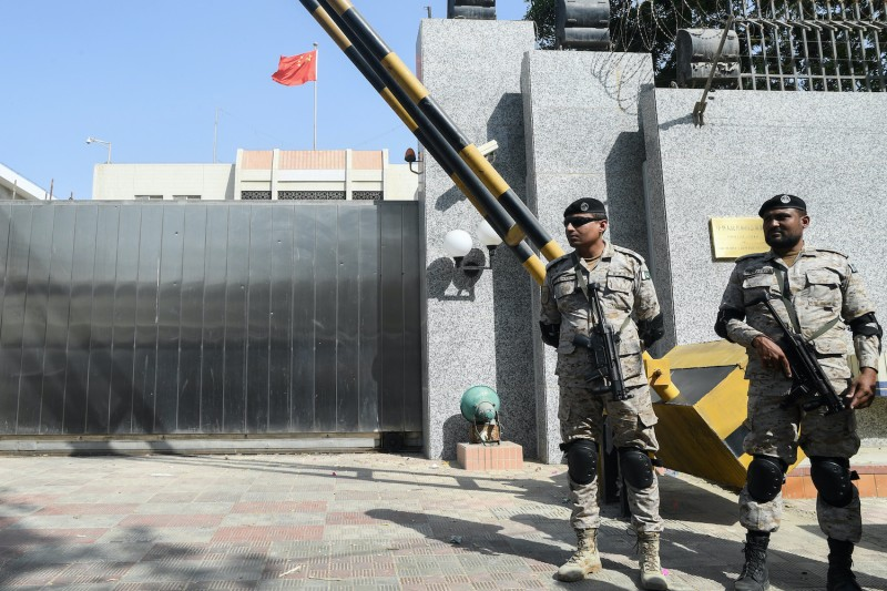 Pakistani rangers stand in front of the Chinese consulate.
