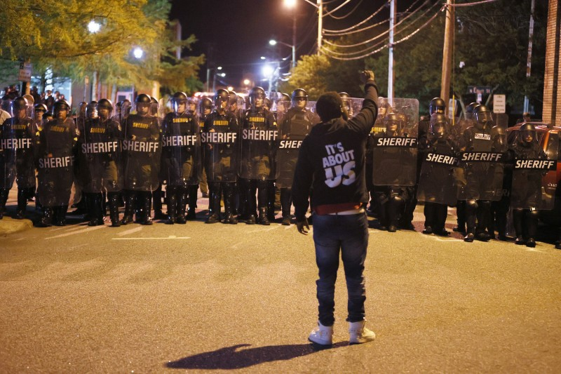 Law enforcement officials in riot gear force people protesting the police killing of Andrew Brown Jr. off a street in Elizabeth City, North Carolina, on April 28.