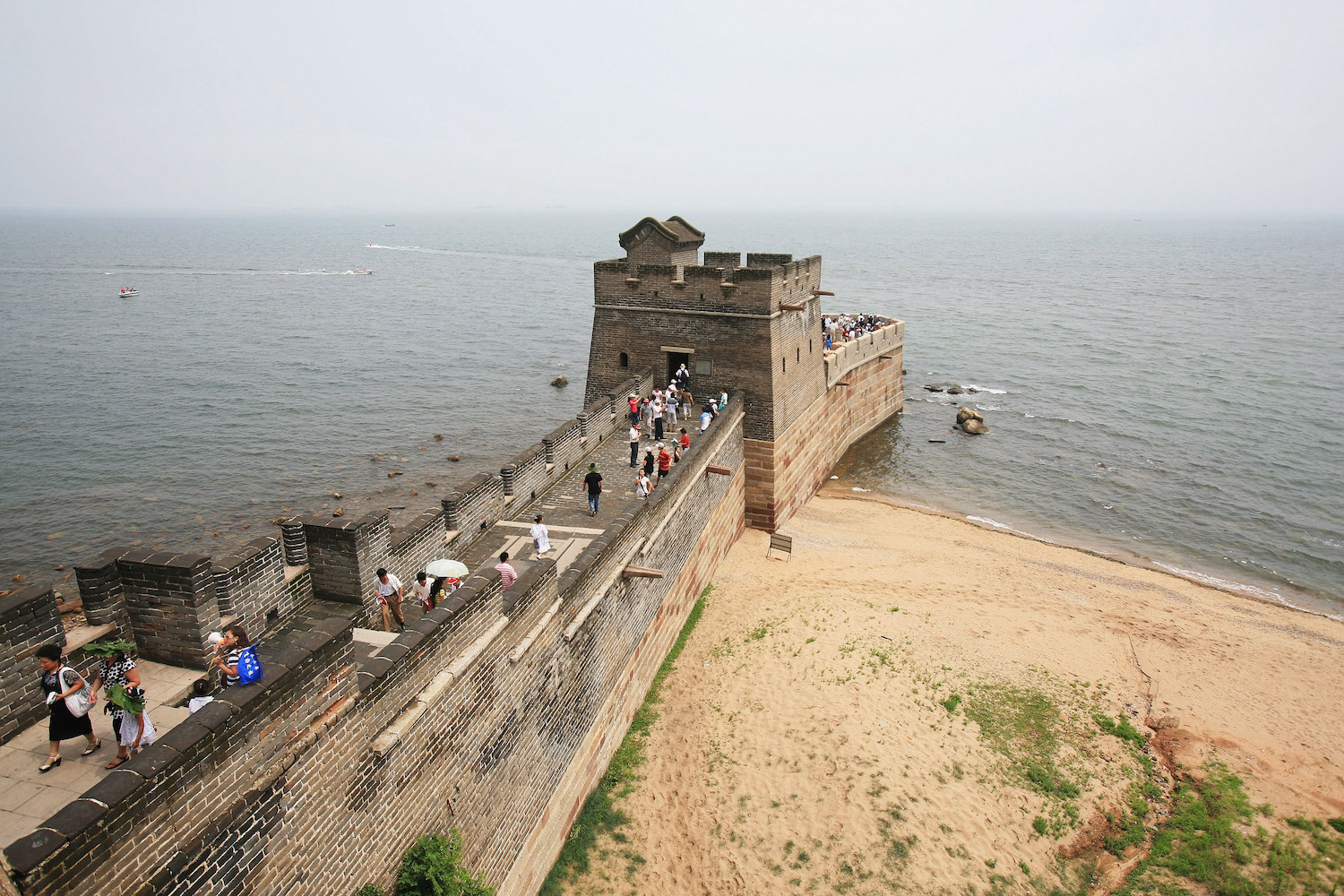 Tourists visit the Old Dragon's Head section of the Great Wall in Qinhuangdao, China, on July 9, 2009.
