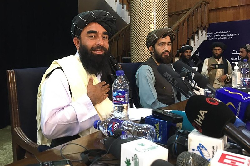 Taliban spokesperson Zabihullah Mujahid arrives at the first press conference in Kabul following the Taliban's takeover of Afghanistan on Aug. 18.