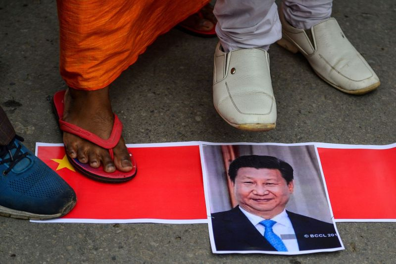 Bharatiya Janata Party supporters prepare to burn posters of Chinese President Xi Jinping during an anti-China protest in Allahabad, India, on June 17, 2020.
