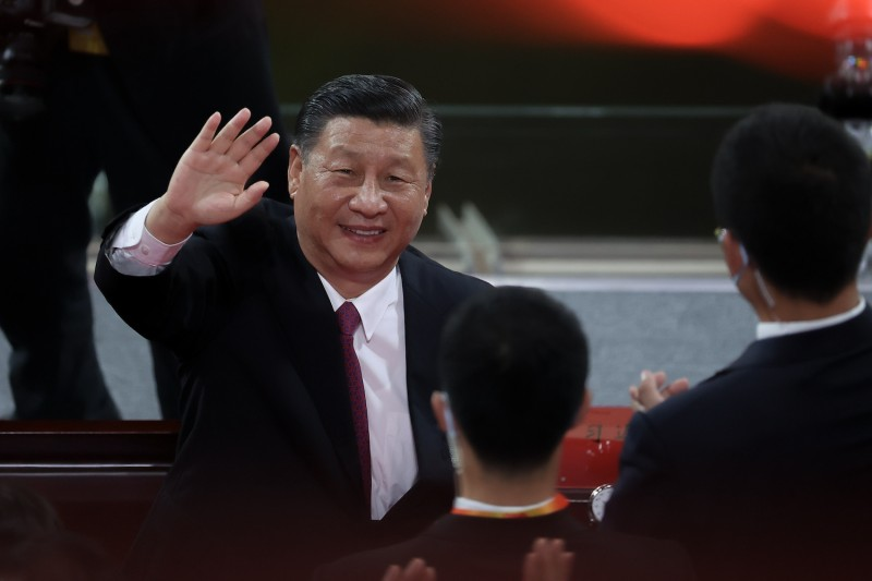 Chinese President Xi Jinping waves at the Birds Nest stadium in Beijing on June 28.