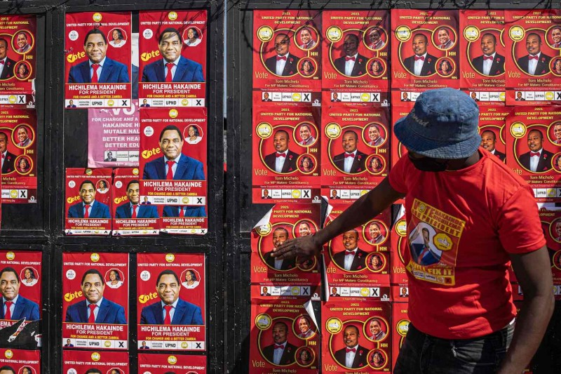 A man closes a door at the Matero district party headquarters of the Zambian opposition party, United Party for National Development, in Lusaka, Zambia, on Aug. 10.