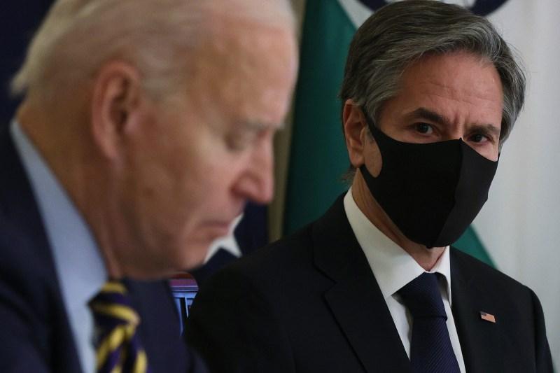Secretary of State Antony Blinken and President Joe Biden participate in a virtual diplomatic meeting.