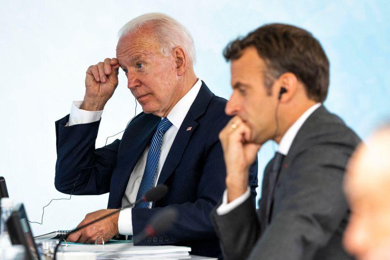 U.S. President Joe Biden and French President Emmanuel Macron sit together at the G-7 summit in Cornwall, United Kingdom, on June 13.