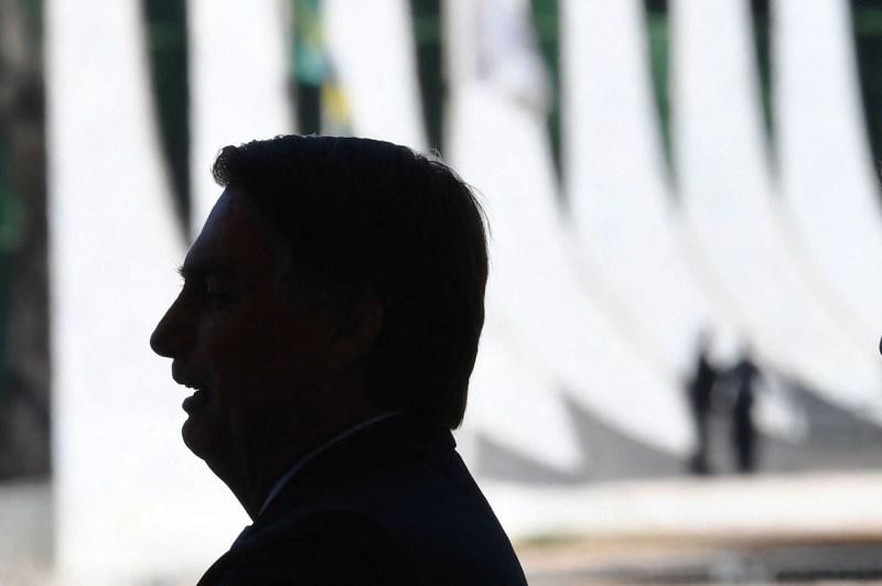 Brazilian President Jair Bolsonaro waits for Bissau-Guinean President Umaro Sissoco Embaló.