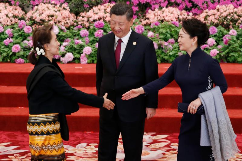Aung San Suu Kyi meets Xi Jinping.