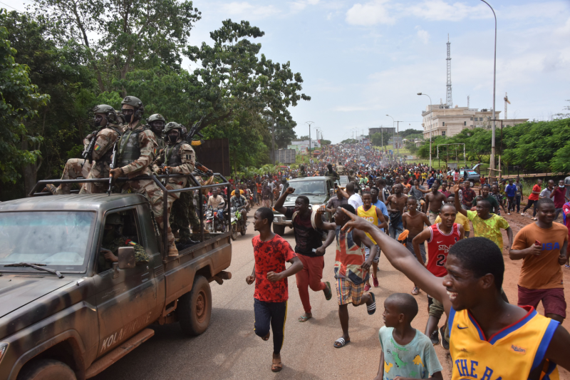 People celebrate in the streets in Guinea.