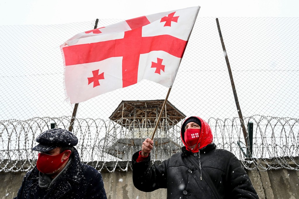 Georgian opposition supporters take part in a rally following the arrest of Nika Melia, the leader of the United National Movement, in the town of Rustavi on Feb. 24.