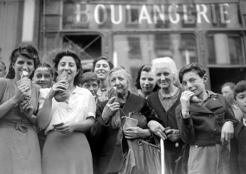 Parisians buy bread in August 1944, after years of living off of rations.