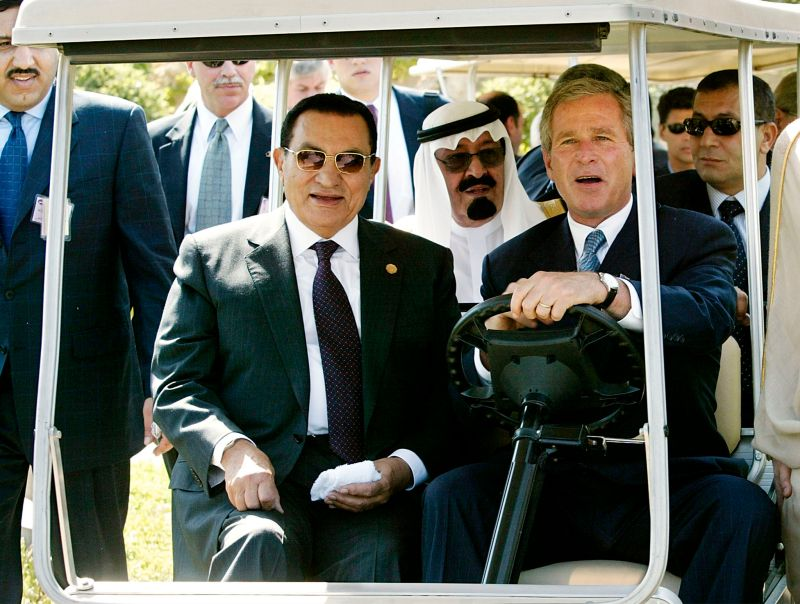 The U.S. and Egyptian presidents ride to an event.