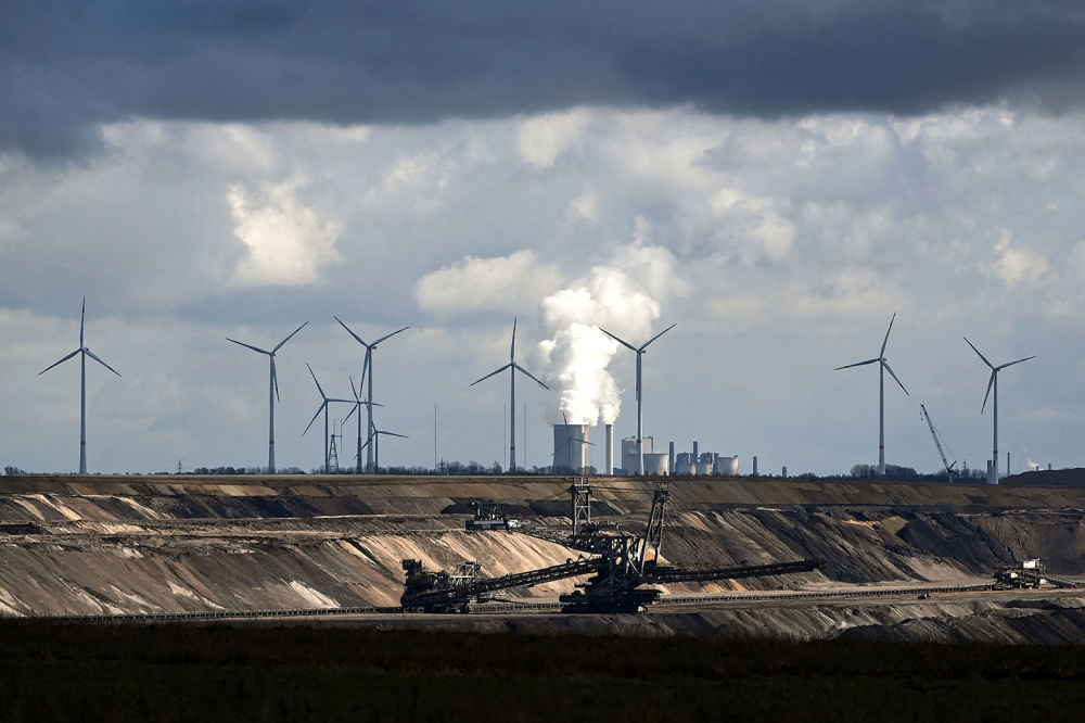 Wind turbines are seen near the open-cast mining and the coal-fired power station Neurath of German energy giant RWE in Garzweiler, Germany on March 15.