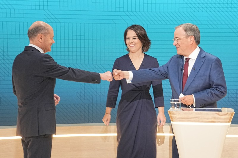 German chancellor candidates wait for start of an election debate.