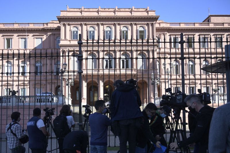 Camerapeople and photojournalists stand guard outside the Casa Rosada government palace in Buenos Aires on Sept. 16.