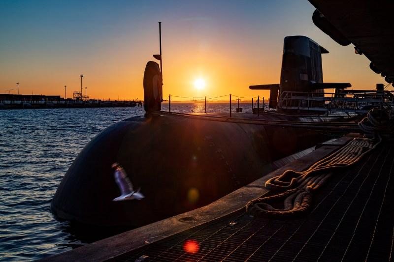 The sun rises over a Royal Australian Navy submarine.