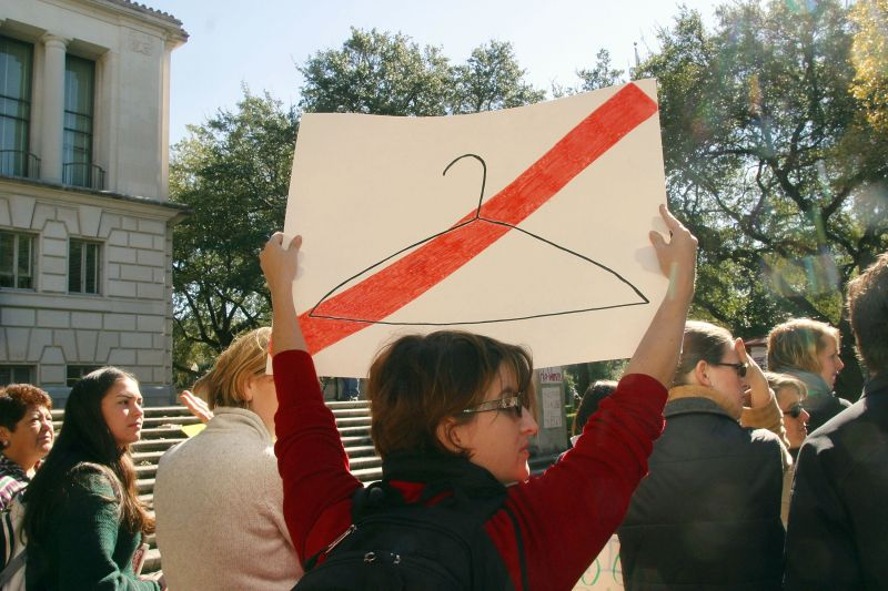 Students from the University of Texas hold signs during a rally in favor of abortion rights November 24,2003 in Austin, Texas.