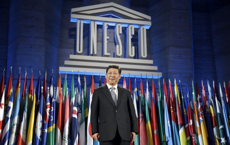 Chinese President Xi Jinping poses after delivering his speech.