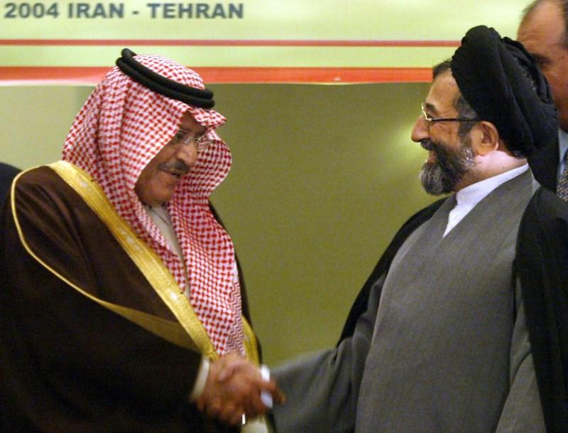 Iranian Interior Minister Abdolvahed Moussavi-Lari shakes hands with Saudi Prince Nayef bin Abdul Aziz.