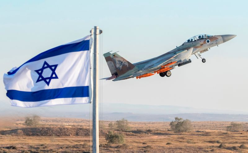 An Israeli Air Force F-15 Eagle fighter plane performs at an air show during the graduation of new cadet pilots at Hatzerim base in the Negev desert, near the southern Israeli city of Beer Sheva, on June 29, 2017.