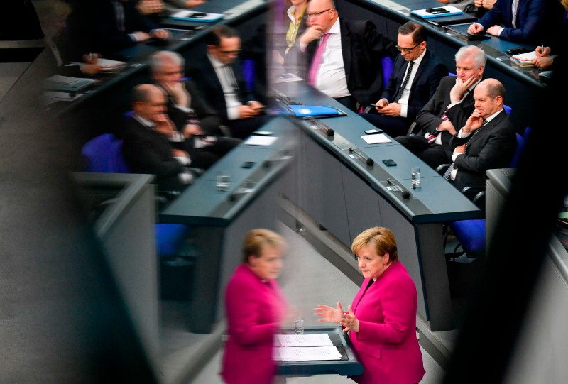 A meeting at the Bundestag in Berlin occurs.