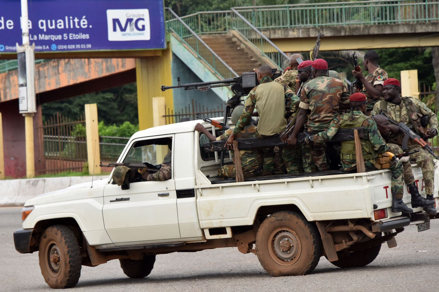 Soldiers from Guinea drive through the Guinean capital of Conakry amid a military overthrow of Guinean President Alpha Condé.