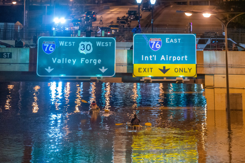 Kayakers on a flooded interstate in Philadelphia