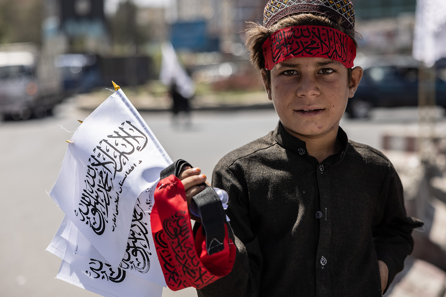 A child sells Taliban flags and bandanas in Kabul .
