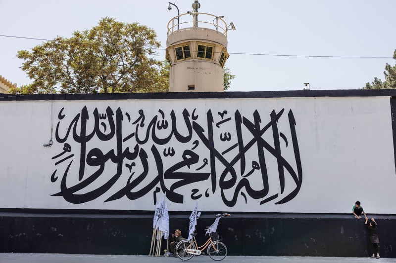 The flag of the Islamic Emirate is painted on the wall outside the former U.S. Embassy in Kabul