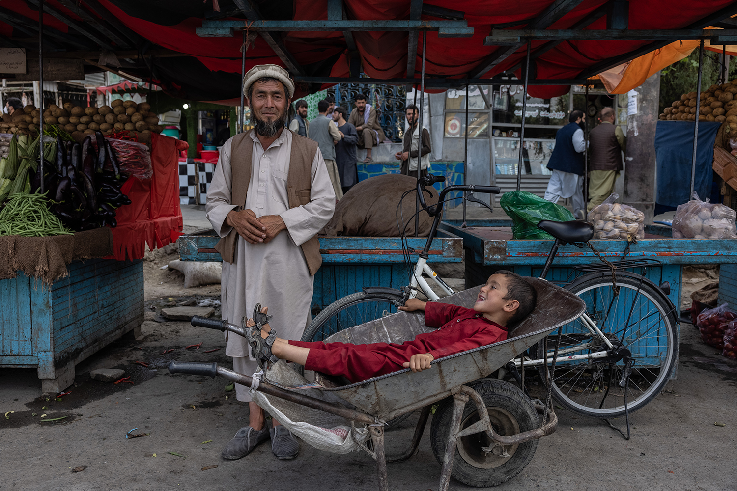 A father and son at the market in Kabul.
