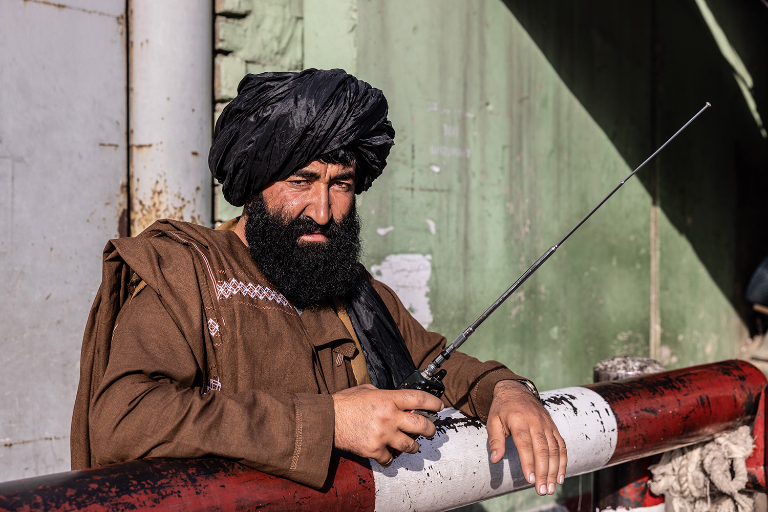 A Taliban guard mans a checkpoint in central Kabul on Sept. 2.